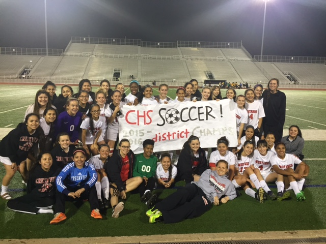 Creekview Girls soccer team on a field holding a sign that says 2015-2016 District Champs