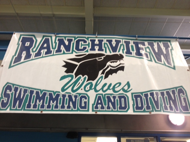 Ranchview Swimming and Diving with wolves mascot on banner