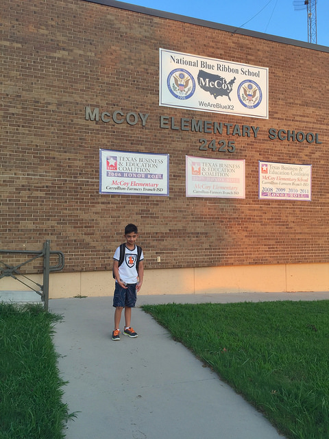 Student standing in front of Mccoy Elementary