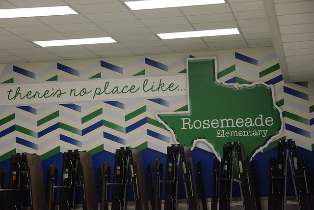a mural on the wall with white, green, and blue designs that say there's no place like Rosemeade Elementary