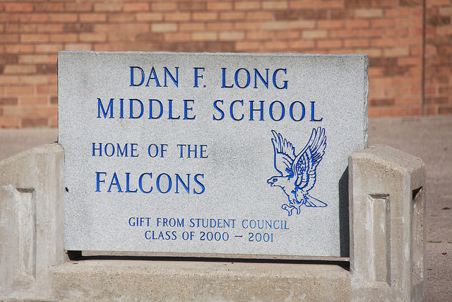 concrete block that says Dan F. Long Middle School Home of the Falcons.  Gift from Student Council Class of 2000-2001