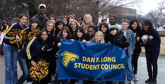 a group of students holding a banner that says Dan F. Long Student Council