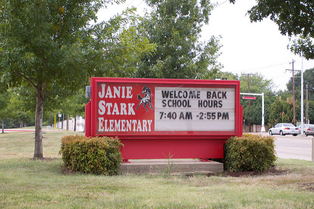 Stark Elementary sign in front of school that says Welcome Back, School Hours are 7:40 A M to 2:55 P M