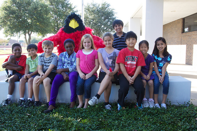 Group of 10 students at Kent Elementary with the Cardinal Mascot in the back.
