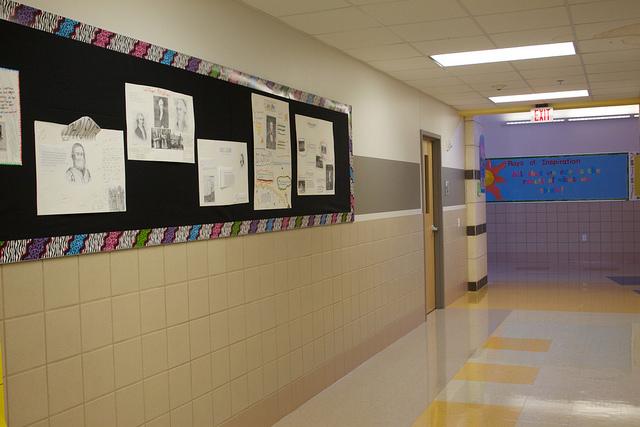 Hallway with a billboard showcasing students' work