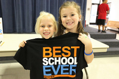 two girls holding a shirt that says best school ever