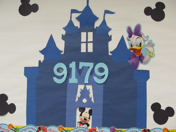 A poster of a castle with mickey mouse in it that has a number of 9179 on it