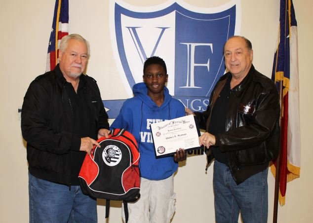 Two men presenting a Field Student with a certificate for Patriots Pen Essay Contest