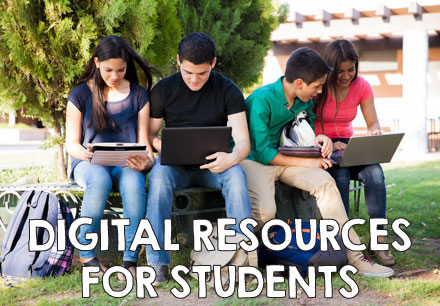 digital resources for students, a group of students on their laptops outside.
