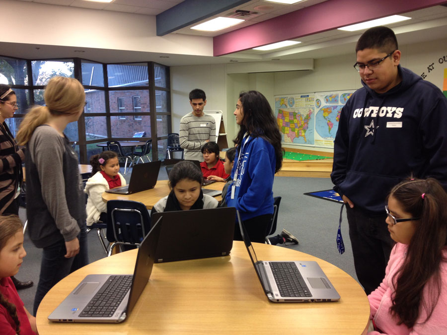 Students from Turner High School collaborating with central students for hour of coding.