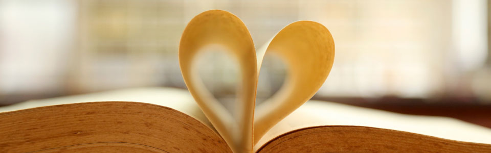 book with pages folded inward in the shape of a heart