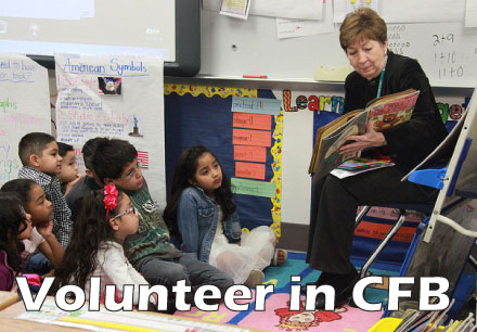 Volunteer in CFB, a woman reading to a class