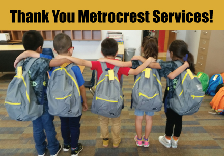 "Kids with their kid friendly backpacks from metrocrest services. Text says ""Thank you Metrocrest Services!"""