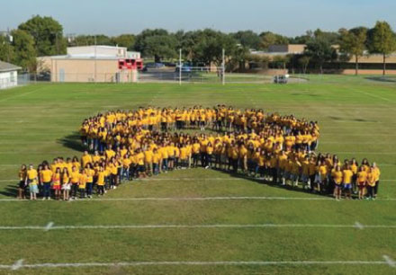 Students and staff honored the life of Sammy Rangel by forming a gold ribbon to signify the fight against childhood cancer.