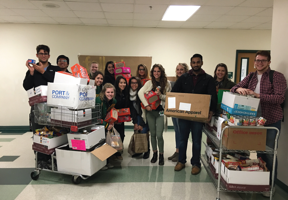 The Newman Smith Leadership class helped run a food drive collection during the week of 11/28-12/2 with over 1,500 food items donated by staff and students. All items will be delivered to the Metrocrest Social Services to help assist families in need right here in our community!