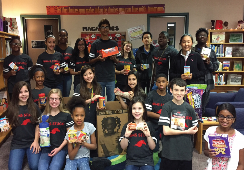 The Student Council at Barbara Bush IB World School have been hard at work collecting food for the North Texas Food Bank. By making daily announcements and having a grade level challenge, the students collected 200 food items to deliver just in time for the holiday break. The fine arts department made extra challenges to their students to bring in food items. An online donation campaign was also set up so that parents and community members could go online and donate in the name of Barbara Bush Middle School. Thanks to all who participated in this drive, and thanks to the Student Council for completing some excellent service to their community!