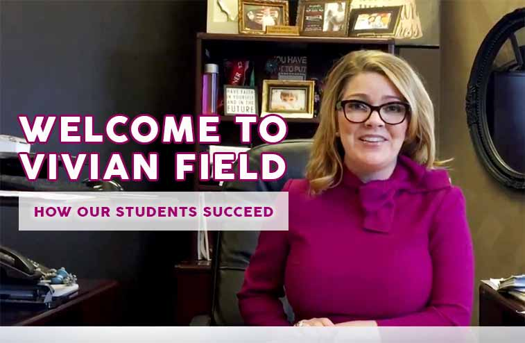 middle school principal in a purple sweater at her desk discusses how her students are a success at her school