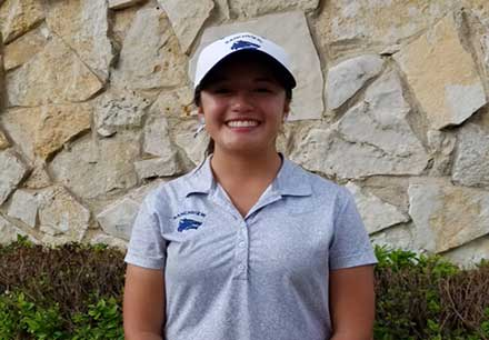 ranchview golfer posing after her record breaking golf round